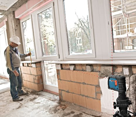 Bosch GPL3 projecting 3 points on a jobsite.