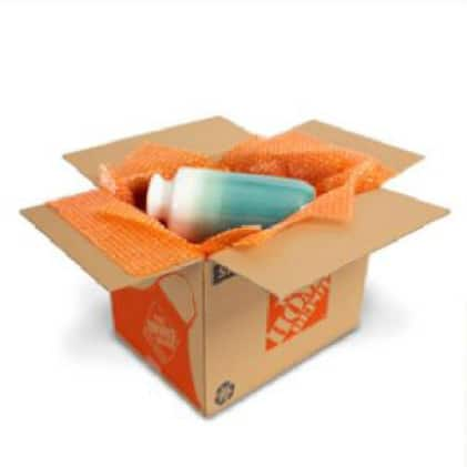 Medium moving box filled with bubble cushion wrap and a ceramic vase