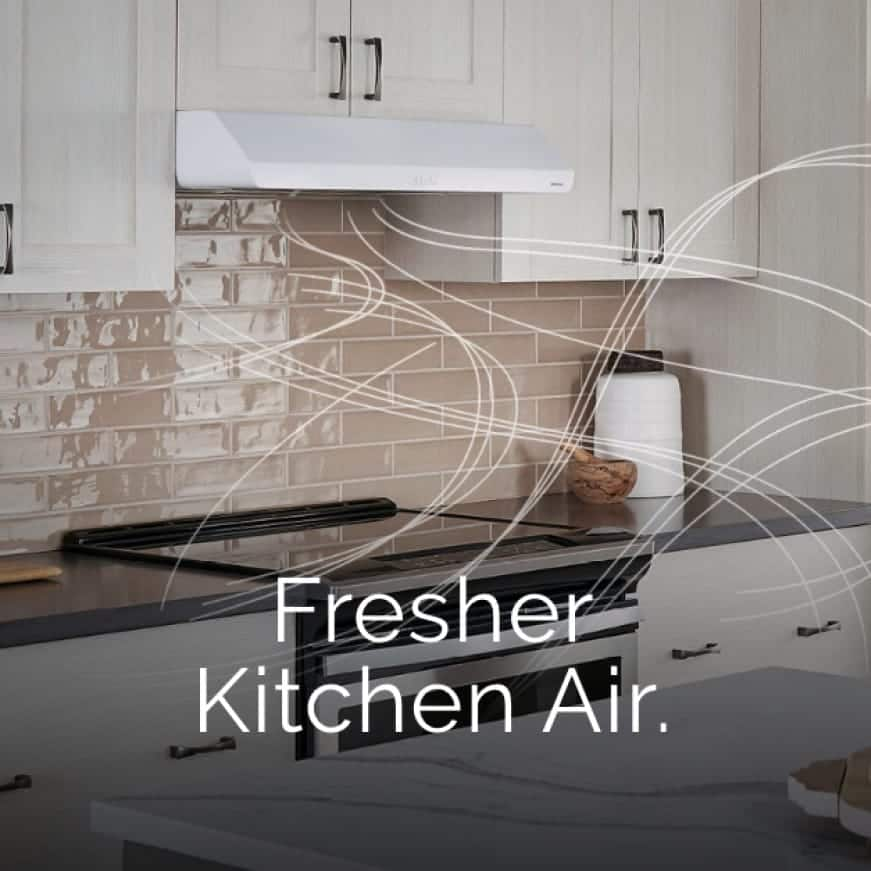A kitchen with a Broan under-cabinet range hood with wispy lines that represent air flowing and words over the image that say: Fresher Kitchen Air