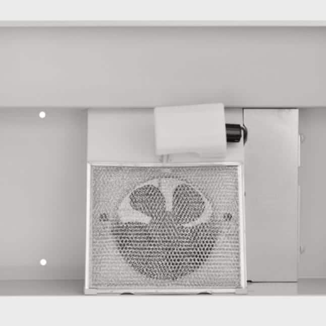 Image of the Broan under-cabinet range hood from the view underneath it so you can see the fan and mesh filter.