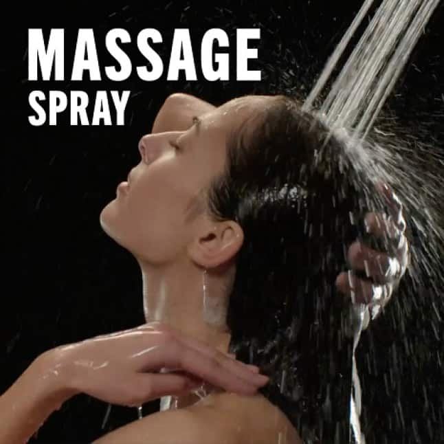 """Image is of a female model (shoulders-up) rinsing her hair with overlaid copy """"Massage Spray"""""""