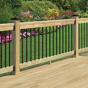 A view of a decking railing install featuring the black round balusters