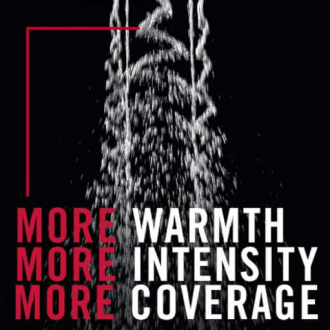 """Image is an up-close view of the H2Okinetic shower spray wave pattern on a black background with the copy """"more warmth, more intensity, more coverage"""""""