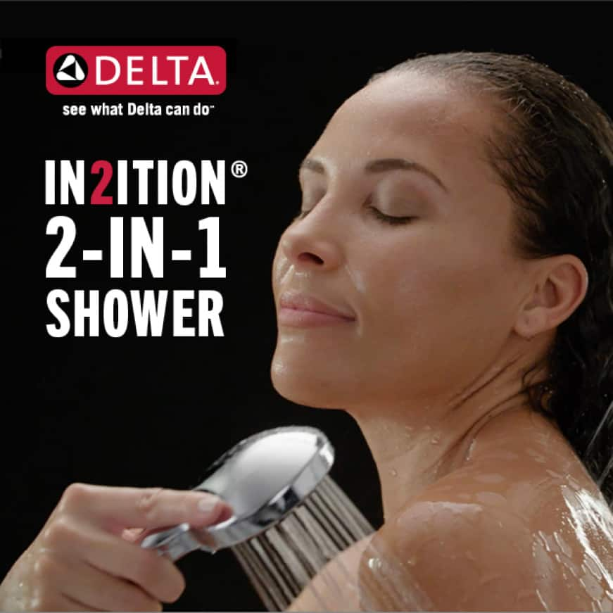 """Image is of a female model showering (shoulders-up) with a hand shower and copy """"In2ition 2-in-1 shower"""""""