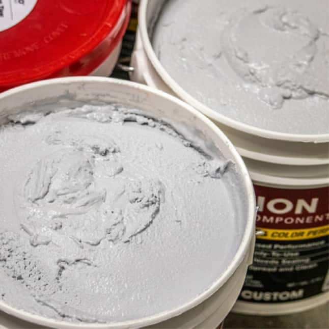 Two pails of same color grout