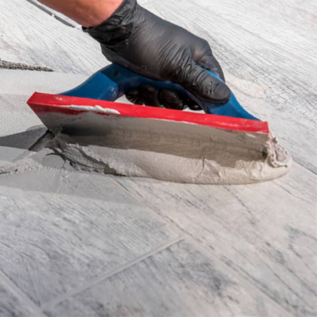Spread grout with float