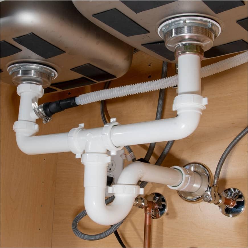 Plastic tubing underneath kitchen sink
