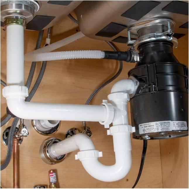 Polypropylene plastic tubing underneath kitchen sink