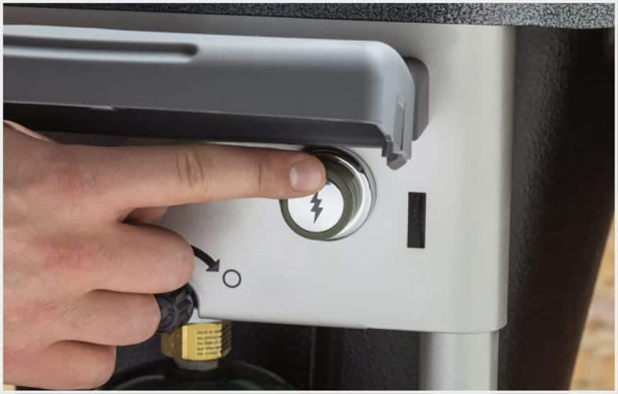 The electronic Touch-N-Go gas ignition system ignites charcoal with the push of a button.