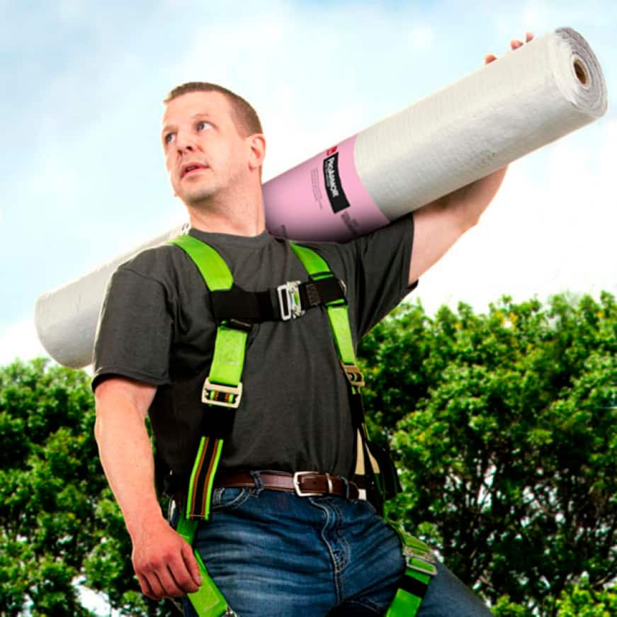 Man carrying a roll of ProArmor Synthetic Underlayment