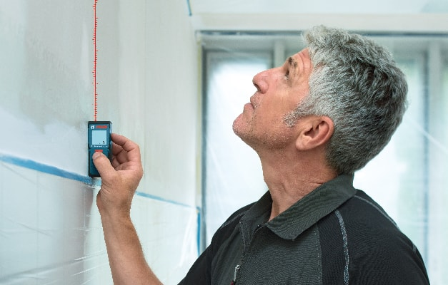 Bosch GLM 30 being used to perform measurement up to ceiling.