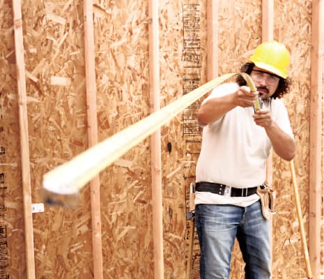 Image of user with bent tape measure illustrating difficulty of a one-man job using tape measure.