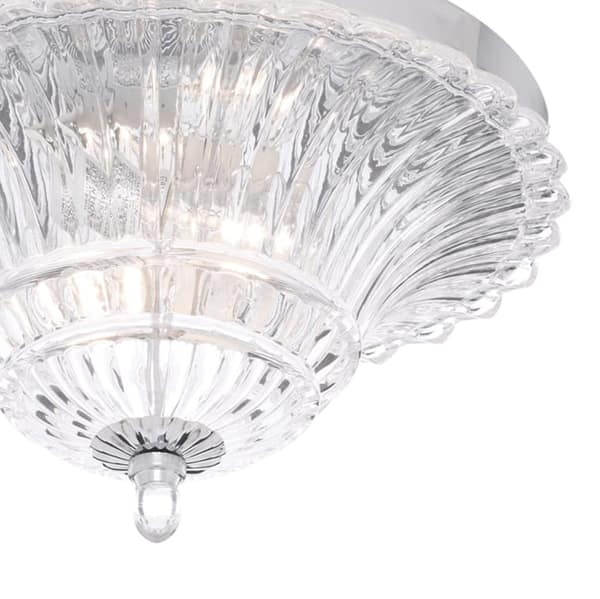 Flush mount light featuring a sophisticated glass shade