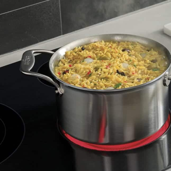 A pot of food is warmed gently on the burner