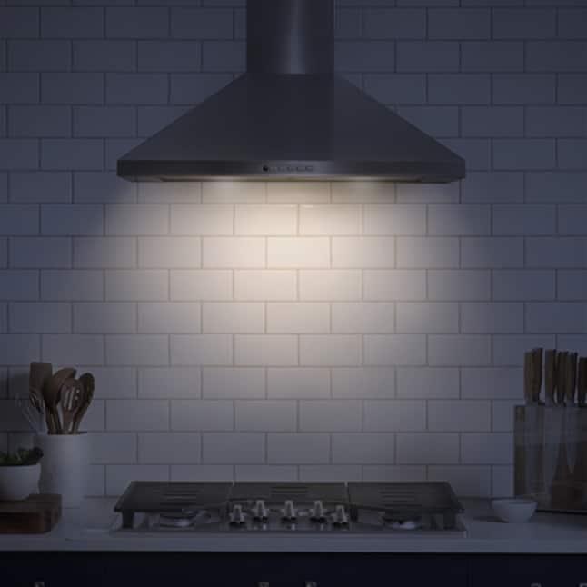The kitchen at night. The light softly illuminates the area.