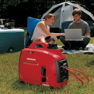 EU1000 Generator powering a laptop at campsite