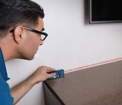 Bosch GLM 50 CX being used to measure shelf.