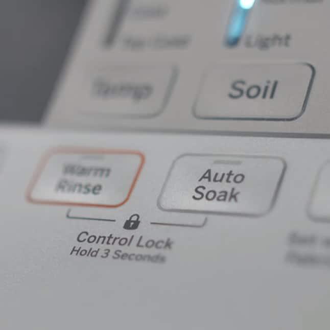 A closeup shot of the auto-soak button