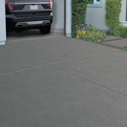 Driveway coated with Granite Grip Gray tone color Mineral Gray GG-17