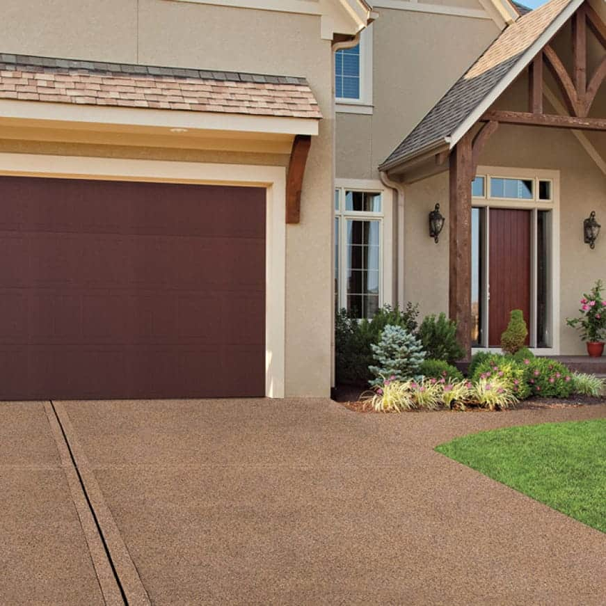 Driveway and walkway to the front door coated with Granite Grip Tan tone color Tan 655