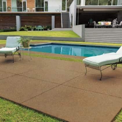 Pool deck with Granite Grip Tan tone color Pebble Sunstone GG-13