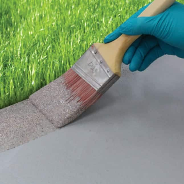Coating the perimeter of the concrete surface with a brush.