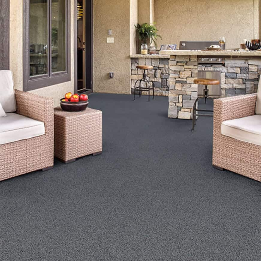 Outdoor concrete patio with furniture and the floor is coated with Granite Grip Gray tone color Galaxy Quartz GG-08
