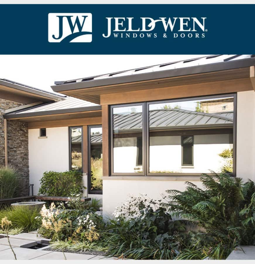 Exterior home with bronze clad-wood windows and beige stucco