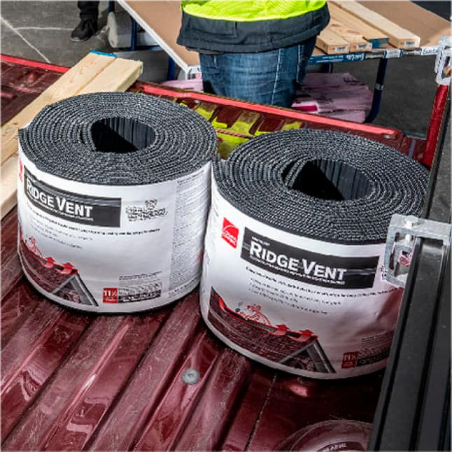 Rolls of Owens Corning Ridge Vent in the back of a pickup truck