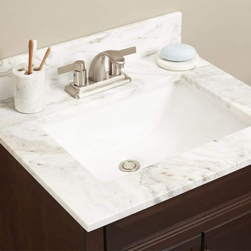 A lifestyle image showing the enhanced look of the bathroom vanity with this vanity top.