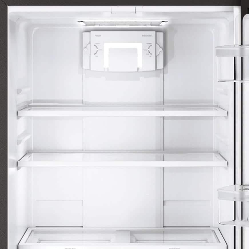 An interior shot of the refrigerator shows the glass shelving.