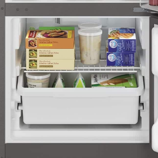 The freezer holds a variety of foods