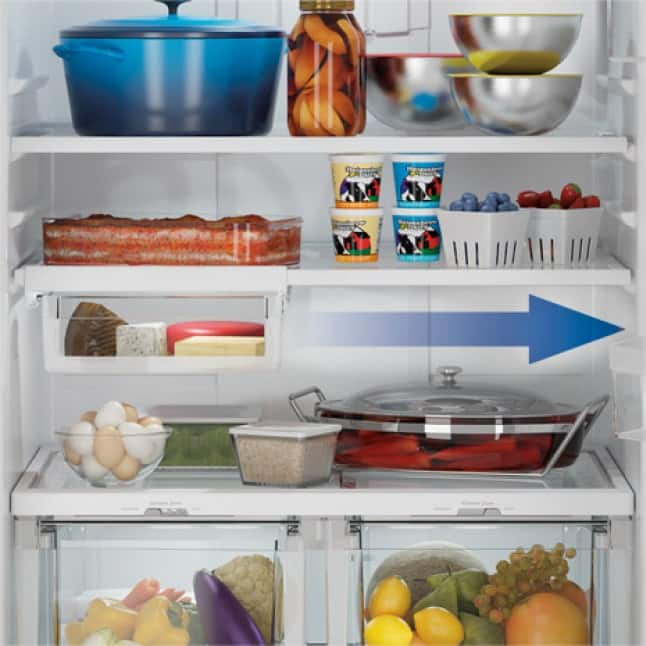 Image of inside of refrigerator with overlay showing how the drawer slides.