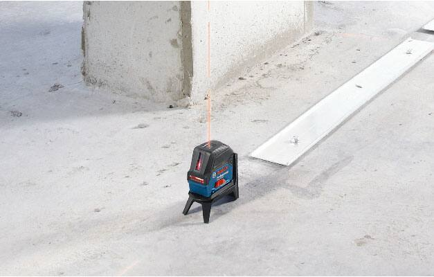 Bosch GCL 2-160 S on floor projecting plumb points on floor and ceiling.