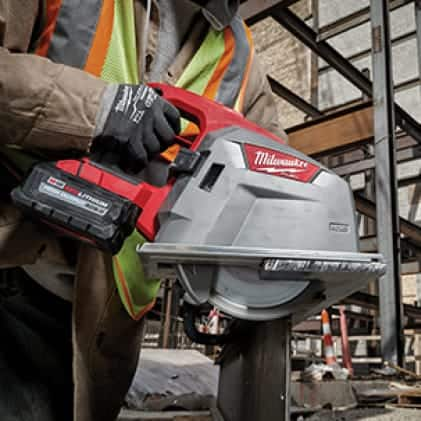 "Man wearing a hi-vis vest and work gloves uses the M18 FUEL 8"" Metal Cutting Circular Saw on corrugated decking"