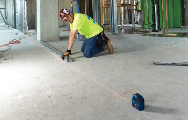 Bosch GLL 50 projecting straight line for alignment on floor.
