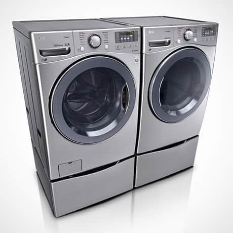 Stainless Steel LG TwinWASH washer dryer pair with LG SideKick Pedestal Washer and pedestal set against a white background