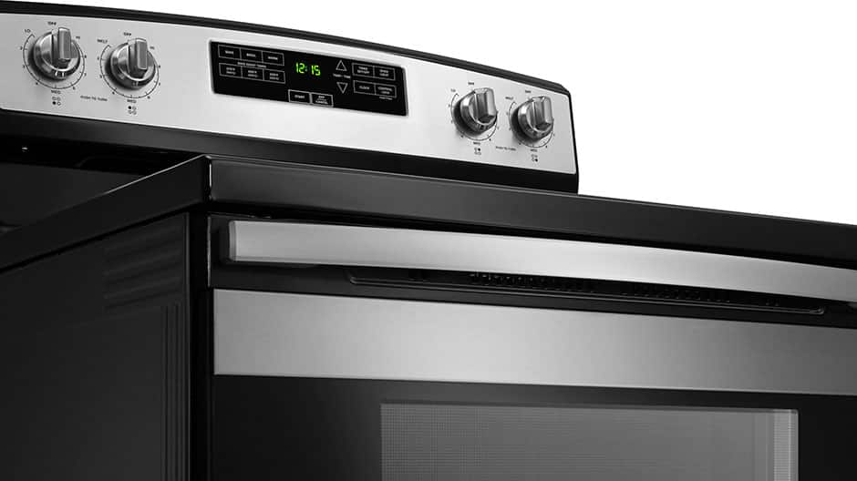 An exterior view of the controls on a stainless steel range.