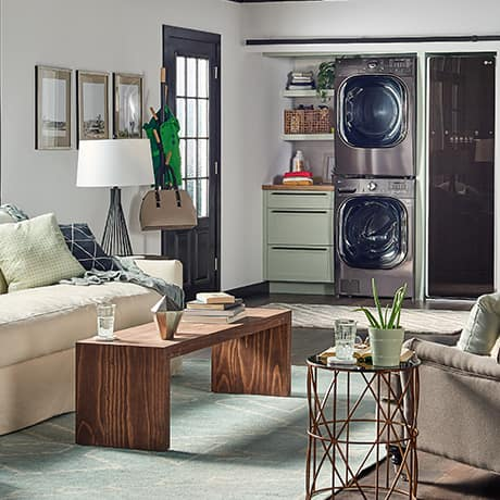 LG Stacked Washer and dryer next to LG Styler in well designed modern loft space