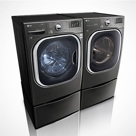 Black LG TwinWASH washer dryer pair with LG SideKick Pedestal Washer and pedestal set against a white background