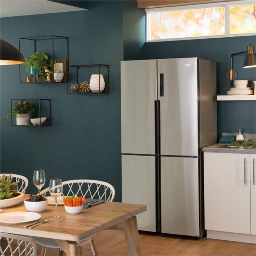 Picture of refrigerator in a kitchen set.