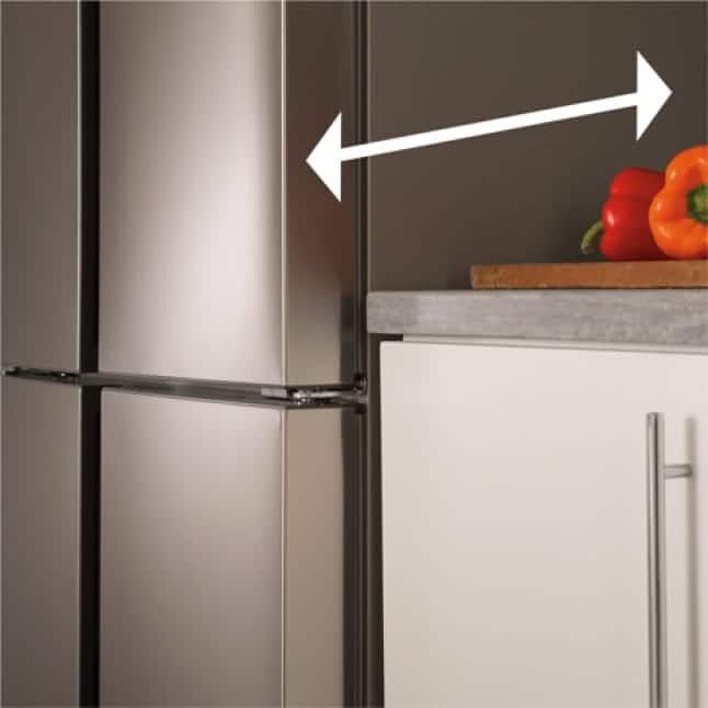 Shot of refrigerator installed and sitting flush with the counter.