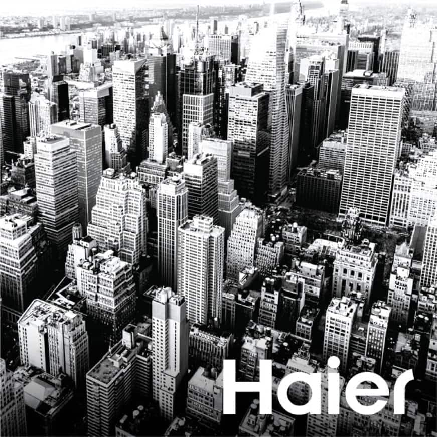 Black and white image of city skyline with Haier logo.