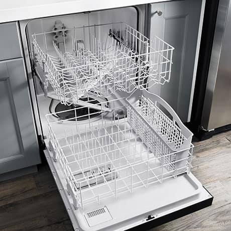 The dishwasher is open to show the spacious upper and lower racks. The lower rack contains a silverware bin.