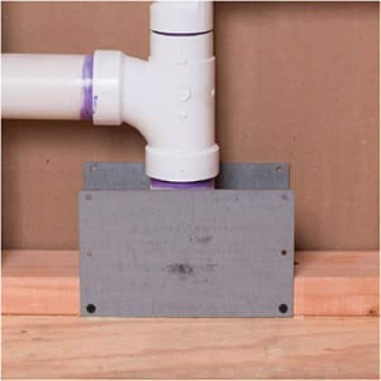 Safety plate protecting DWV piping