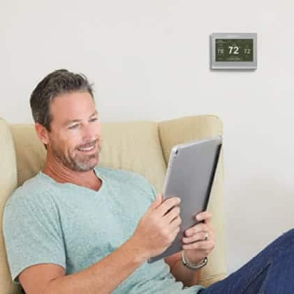 Smart Color thermostat being used to deliver perfect temperature in living room