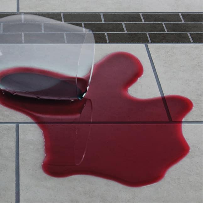 Spilled wine on tile floor