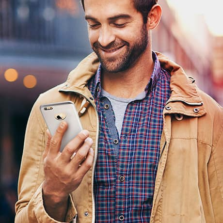 Smiling Man with Phone