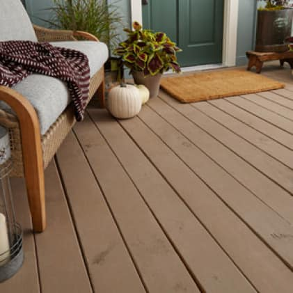 Wood porch entryway coated with BEHR PREMIUM Porch & Patio Floor Paint