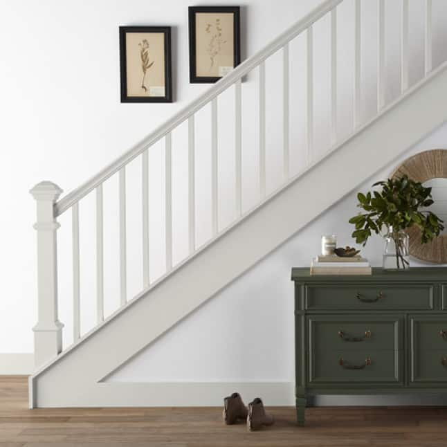 Stairwell railing and bannister painted white